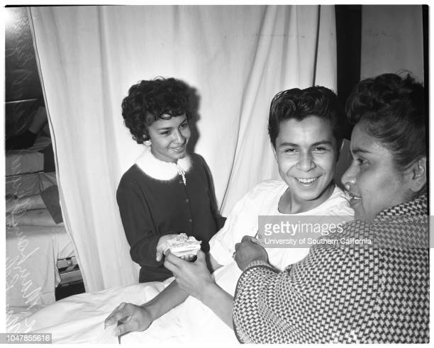 Boy in hospital gets class pin, 30 November 1955. Mary Louise Aguirre -- 14 years ;Raoul Esquivel -- 15 years ;Mrs Ellen Chavez .;Caption slip reads:...