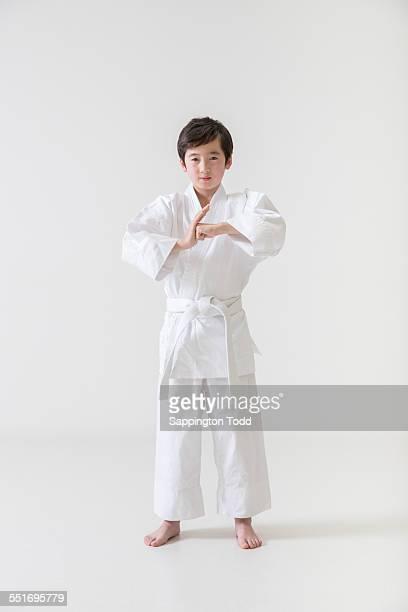 Boy In Karate Uniform