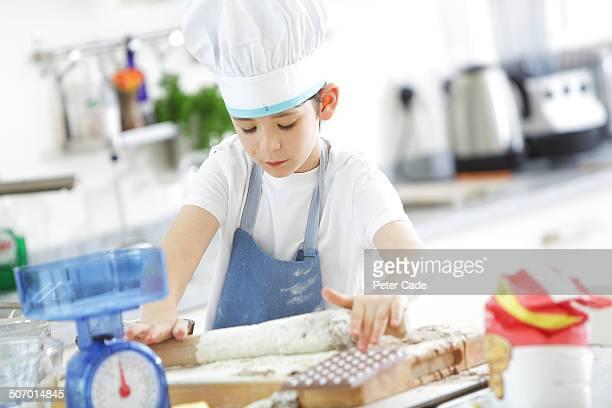 Boy in kitchen baking