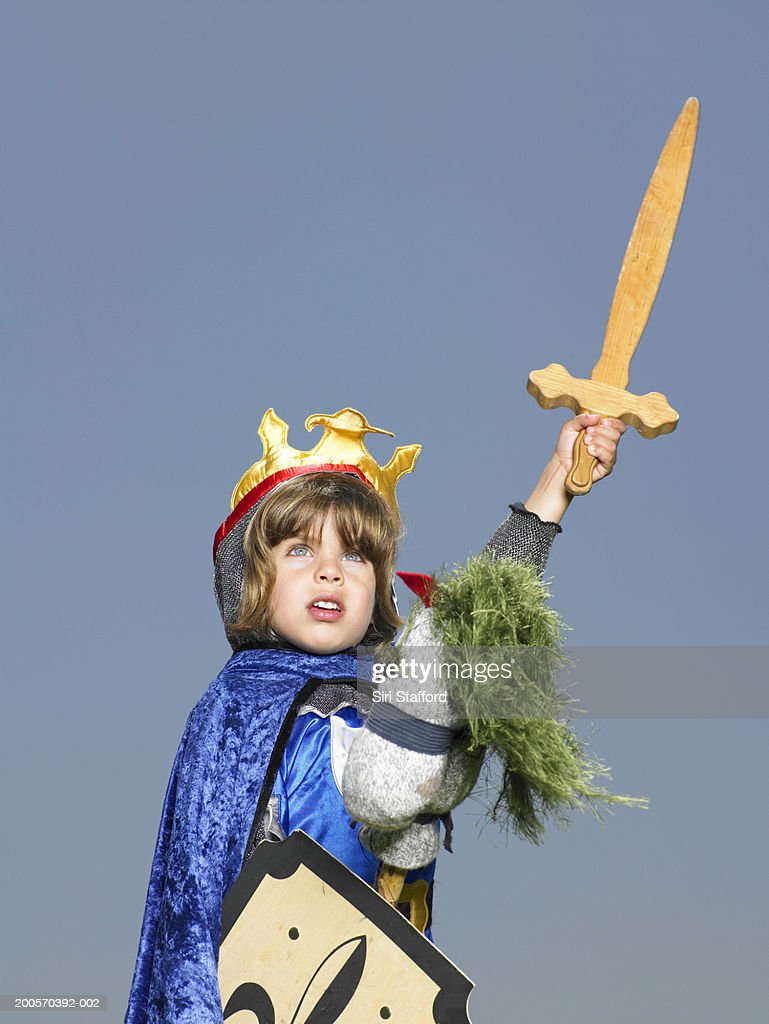 Boy (4-5) in knightu0027s costume riding stick horse holding sword up  sc 1 st  Getty Images & Boy In Knights Costume Riding Stick Horse Holding Sword Up Stock ...