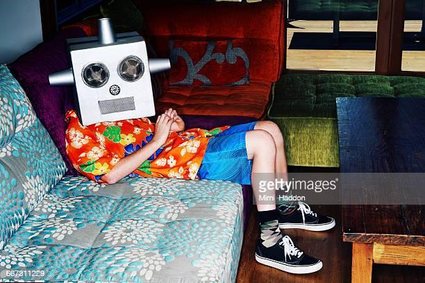 Boy in Living Room Wearing Robot Mask
