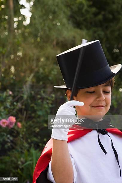 Boy in magician costume