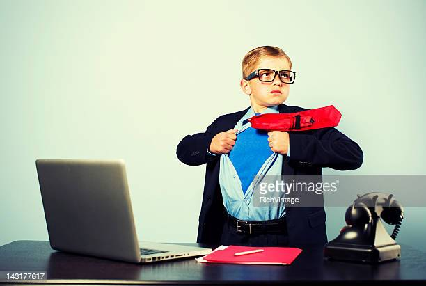Boy in Office Dressed as Superhero at Laptop