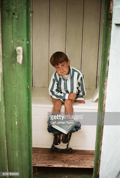 Boy in outhouse