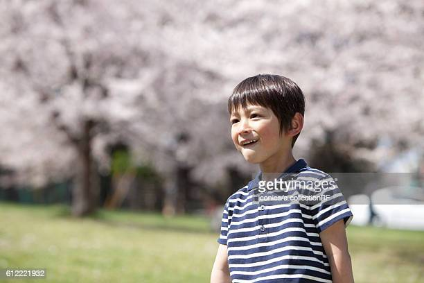 boy in park - 男子生徒 ストックフォトと画像