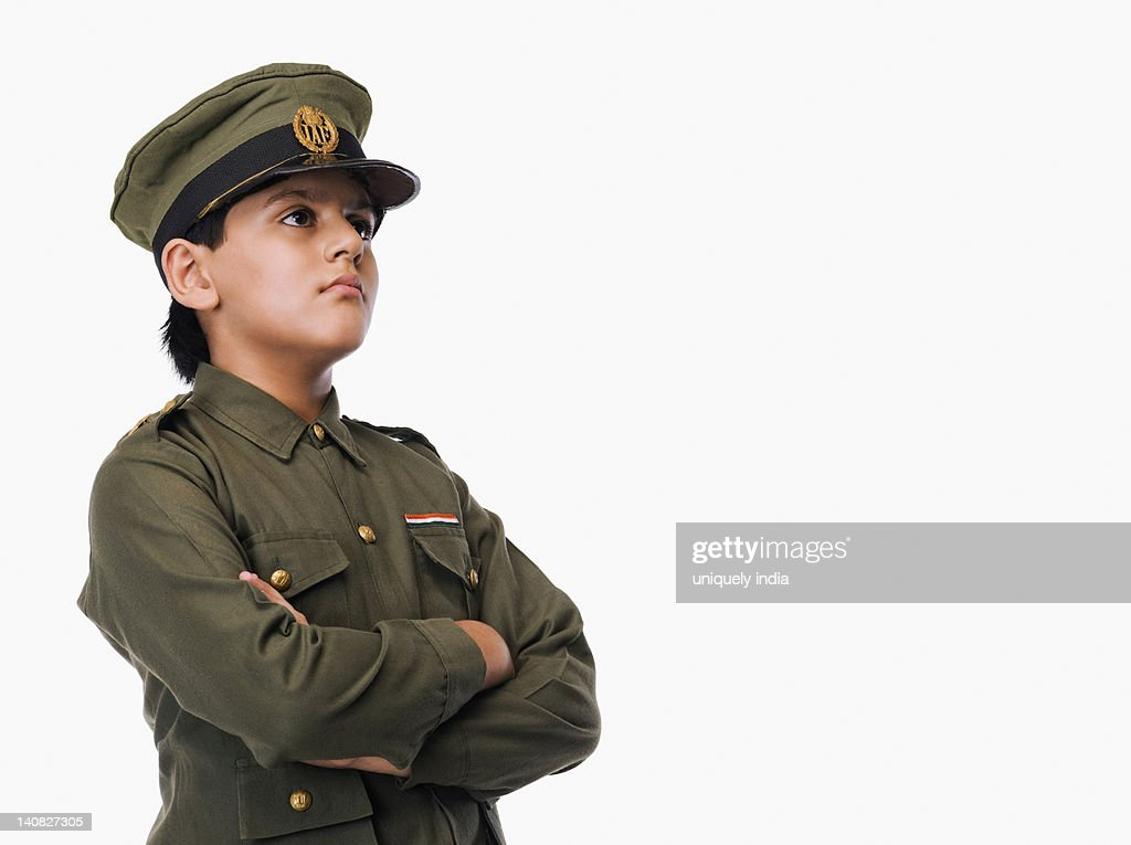 Boy in police uniform with his arms crossed : Stock Photo