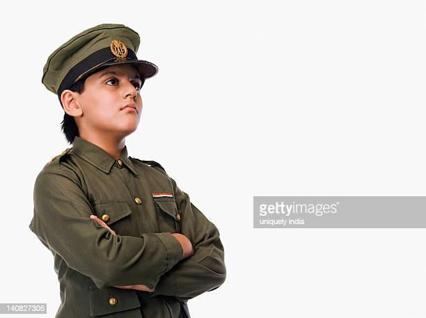 boy in police uniform with his arms crossed - uniform cap imagens e fotografias de stock