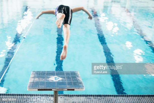 boy in pool for swim practice - diving platform stock pictures, royalty-free photos & images