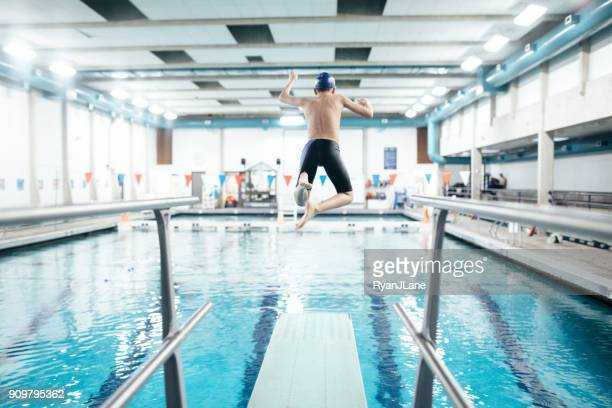 Boy In Pool on Diving Board