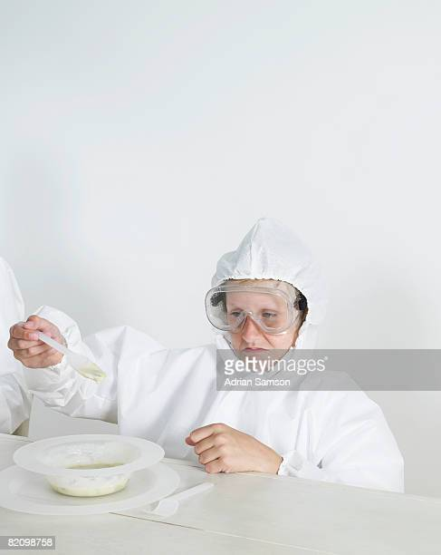 Boy in protective suit dining