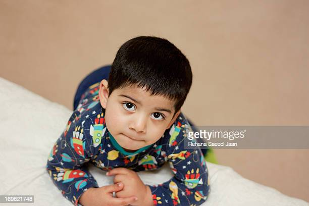 boy in pyjamas - cute pakistani boys stock photos and pictures