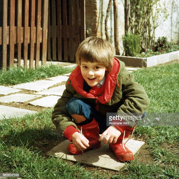 Boy in red rubber boots