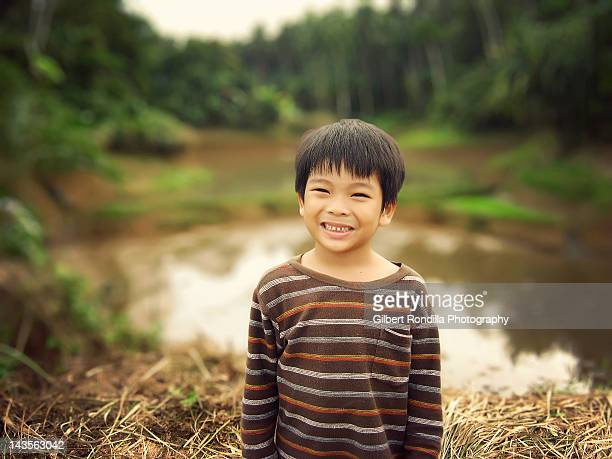 boy in rice field - philippines stock pictures, royalty-free photos & images