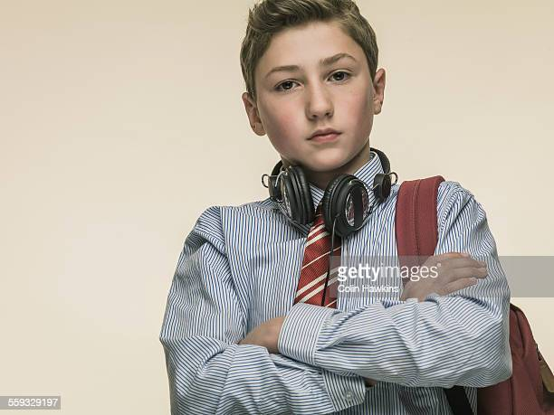 boy in school uniform with headphones - schoolboy stock pictures, royalty-free photos & images