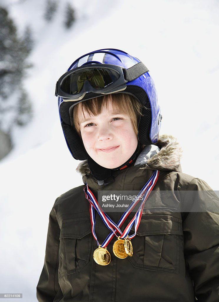 Boy in ski gear with winner medals  : Stock Photo