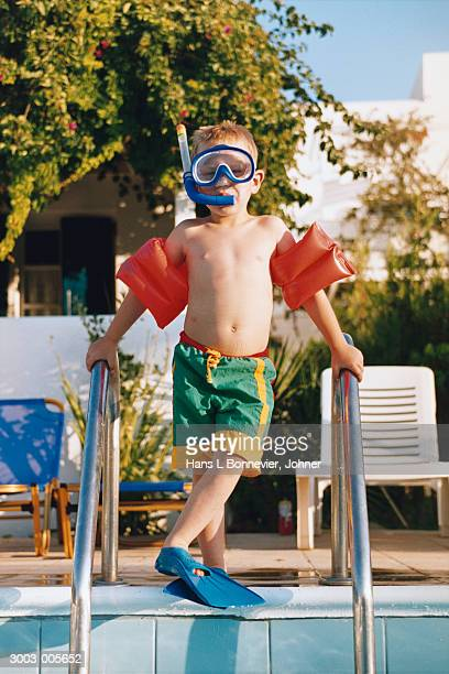 boy in snorkel and water wings - scuba mask stock pictures, royalty-free photos & images