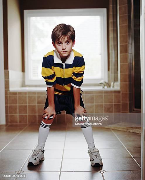 boy (8-10) in soccer uniform standing in bathroom - 10 11 jahre stock-fotos und bilder