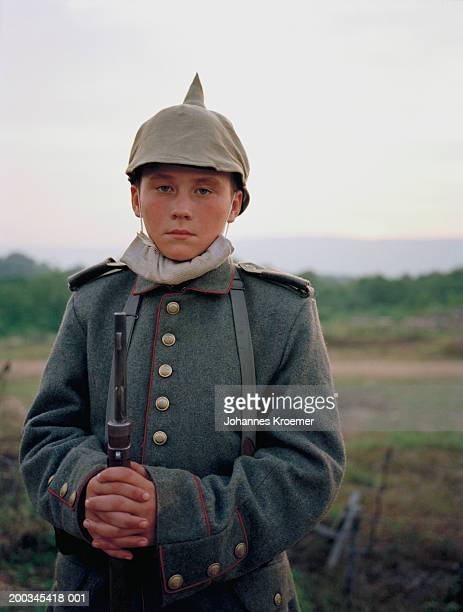 boy (12-14) in soldier costume, portrait - historical reenactment stock pictures, royalty-free photos & images