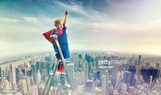 Boy in superman outfit is ready to fight crime