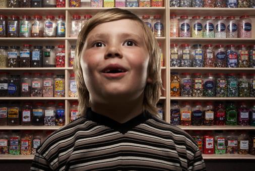 Boy (6-8) in sweetshop, close-up (Digital Composite) - gettyimageskorea