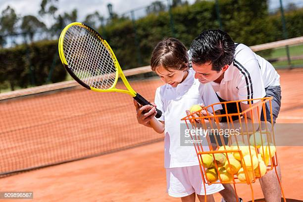 Boy in tennis lessons