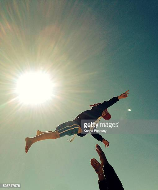 Boy in the air with peace sign