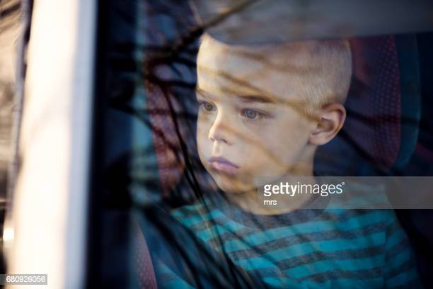 boy in the car - autism spectrum disorder stock photos and pictures
