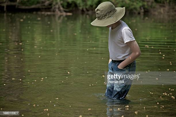 boy in the creek 2 - wet jeans stock photos and pictures