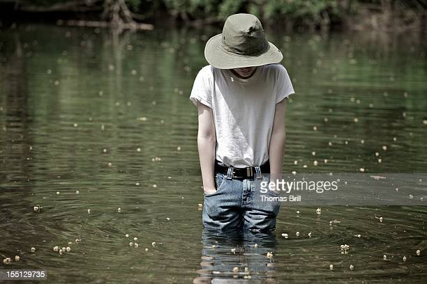 boy in the creek - wet jeans stock photos and pictures