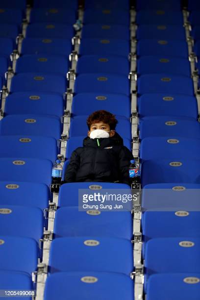 Boy in the stands wear a mask in light of novel coronavirus during the AFC Champions League Group F match between Ulsan Hyundai and FC Tokyo at the...