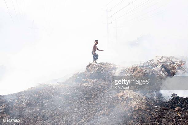 MOHAMMADPUR DHAKA BANGLADESH A boy in the waste burning dumps area producing smoke and toxic pollution at Mohammadpur According to the World Health...