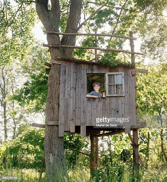 boy in tree house