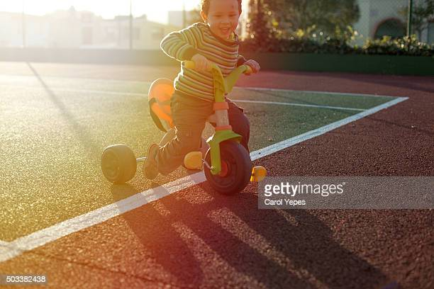 boy in tricycle  backlight