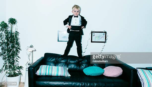 Boy in tuxedo holds a party
