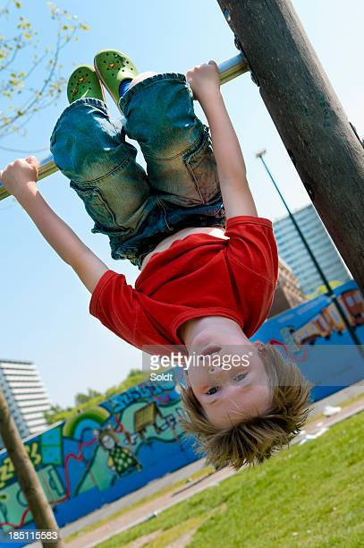 boy in urban playground - borough district type stock pictures, royalty-free photos & images