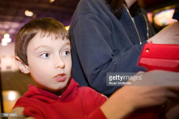Boy in video arcade
