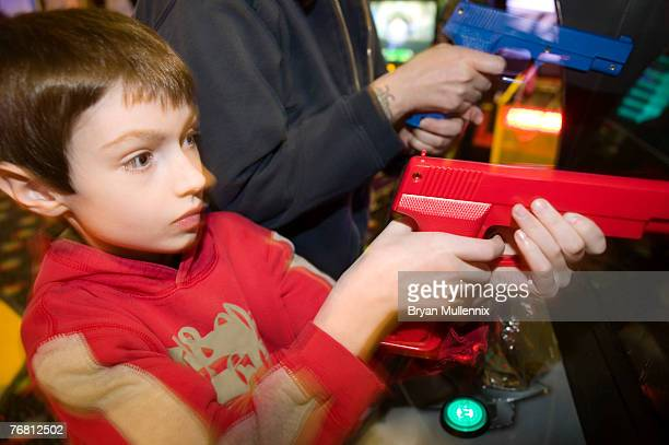 Boy in video arcade