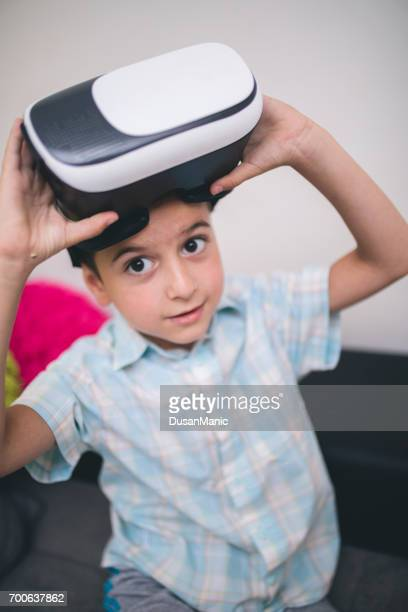 boy in virtual reality glasses playing the game - head mounted display stock photos and pictures