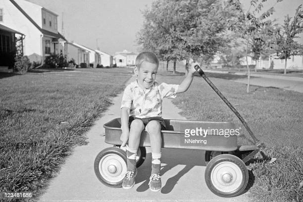 boy in wagon 1957, retro - child photos stock photos and pictures