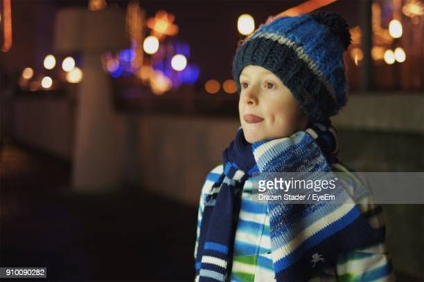 boy in warm cloth standing outdoors at night - drazen stock pictures, royalty-free photos & images