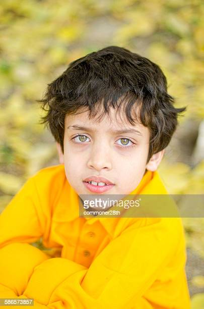 boy in yellow dress - cute pakistani boys stock photos and pictures