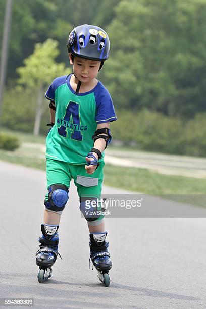 Boy inline skating outdoors