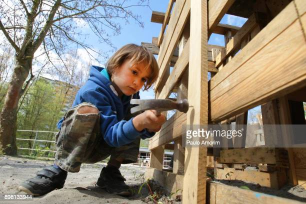 A boy installing new fence on the park