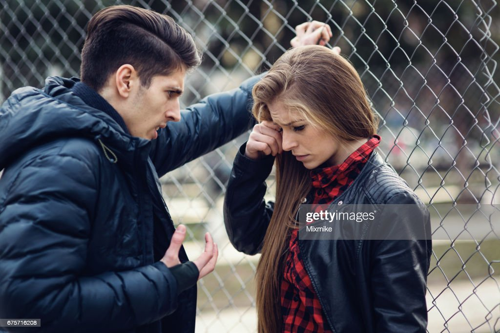 Boy insulting his girlfriend : Stock Photo