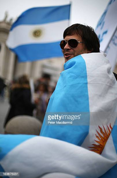 A boy is draped in the flag of Argentina in St Peter's Square after Pope Francis gave his first Angelus blessing on March 17 2013 in Vatican City...