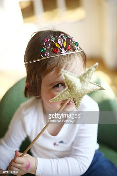 A boy is dressed as a princess