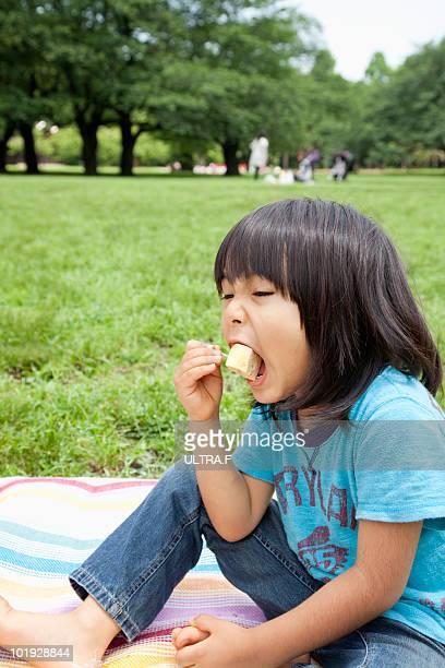 Boy is eating egg.