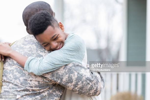 Boy is happy his dad is home from deployment