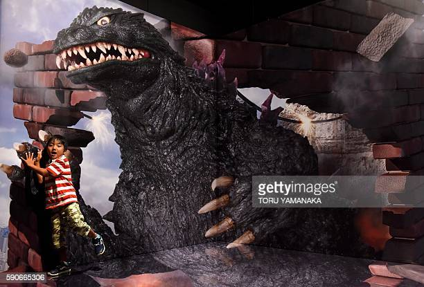 A boy is photographed with a threedimensional image of Godzilla at the Godzilla exhibition in Yokohama suburb of Tokyo to promote latest movie of the...