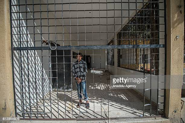 A boy is seen at the Ahmet Selim Mulla high school that was previously used as a jail and torture rooms by Daesh militants in Jarabulus Syria on...